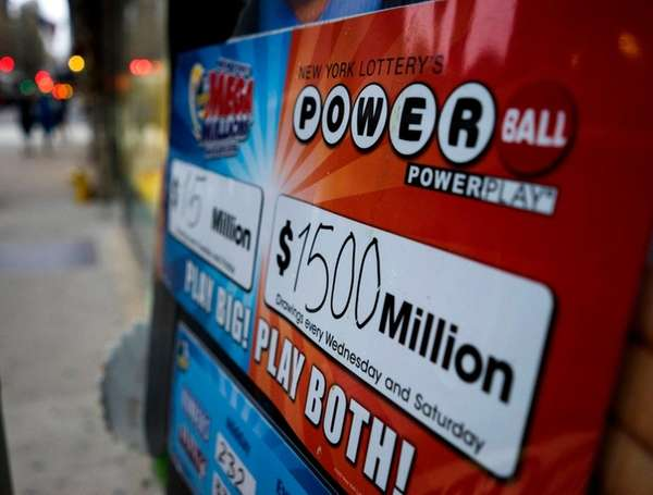 A sign marks the Powerball jackpot at a