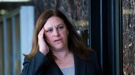 Assistant District Attorney Joan Illuzzi-Orbon walks from the