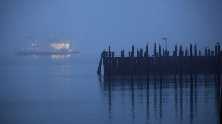 The ferry Grand Republic disappears into the fog