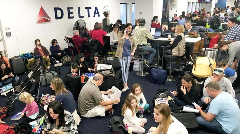 Holiday travelers wait for their flights at LaGuardia