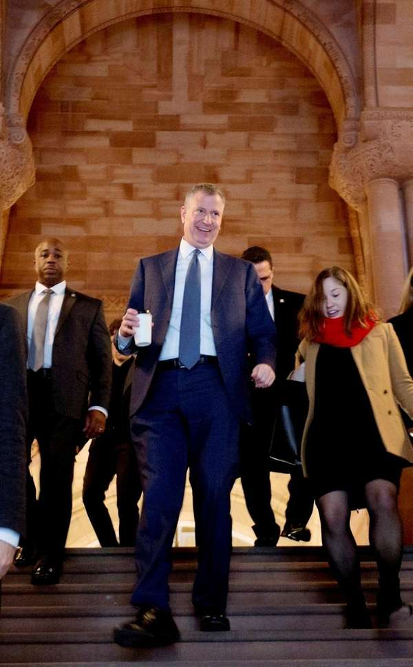 Mayor Bill de Blasio, center, at the Capitol