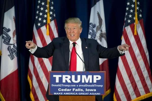 Republican presidential candidate Donald Trump points to the