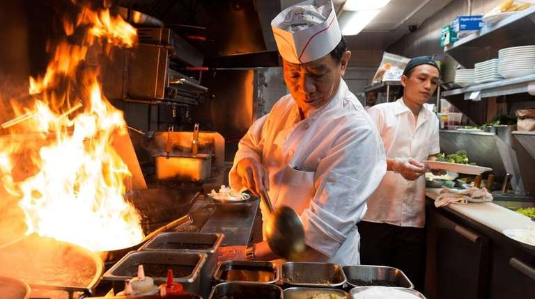 Chef Ding Gen Wang, left, cooks at New