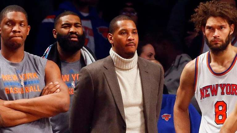 An injured Carmelo Anthony of the New