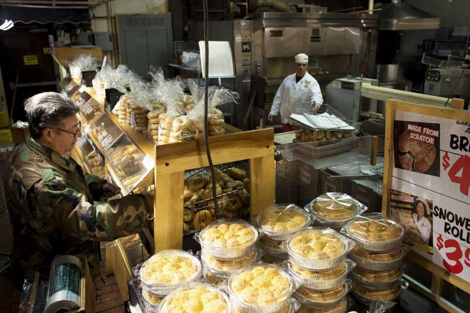 Watch the workers work. Butchers, fishmongers, produce fluffers,
