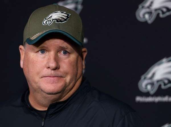 Philadelphia Eagles' head coach Chip Kelly pauses