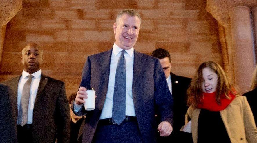 New York City Mayor Bill de Blasio walks