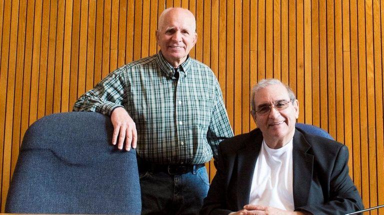 Halesite resident Len Urban, standing, with Huntington Supervisor