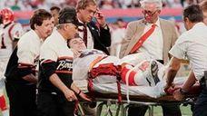 Cincinnati Bengals nose tackle Tim Krumrie is taken