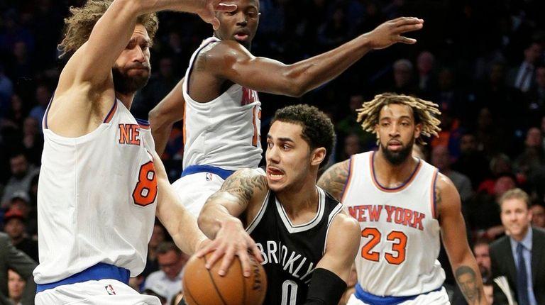 Brooklyn Nets' Shane Larkin (0) passes away from