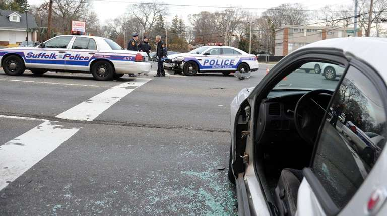 A police car and two other vehicles crashed