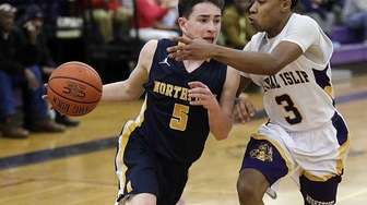 Northport's Brennan Whelan (5) drives the baseline against