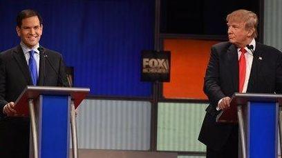 Sen. Marco Rubio, R-Fla., left, speaks as Donald