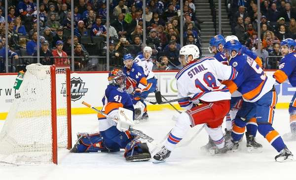 Marc Staal of the New York Rangers scores