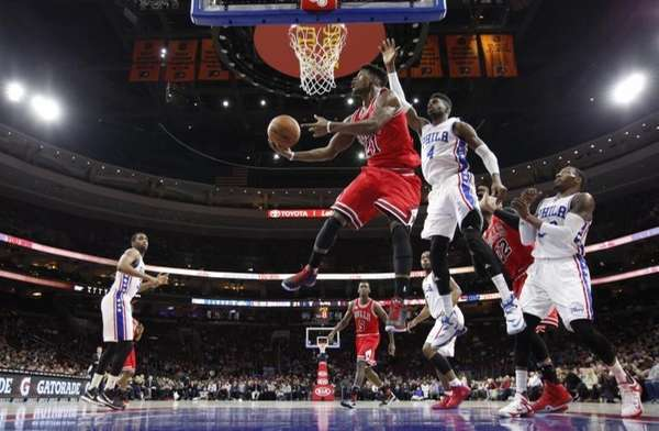Chicago Bulls' Jimmy Butler shoots after getting past