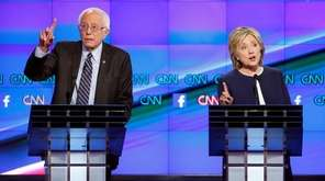 Democratic presidential candidates Hillary Clinton, right, and