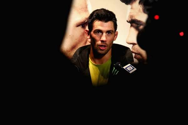 Dominick Cruz answers questions from the media after
