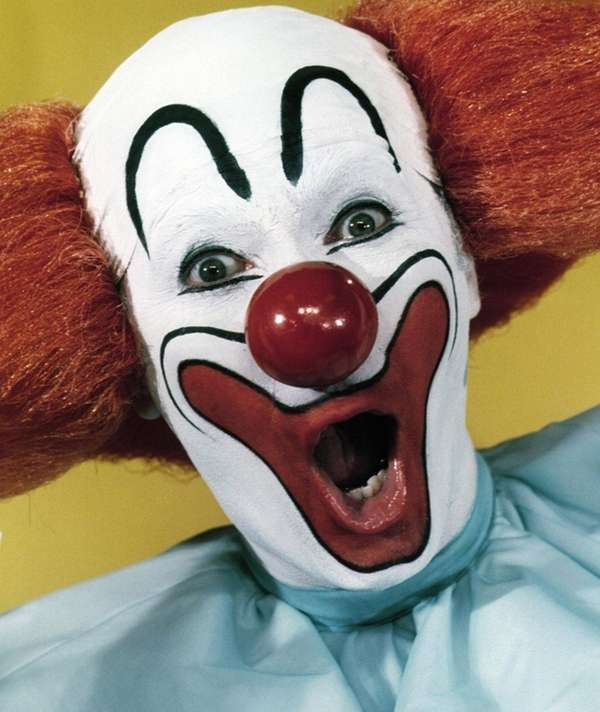 Larry Harmon portrays Bozo the Clown.