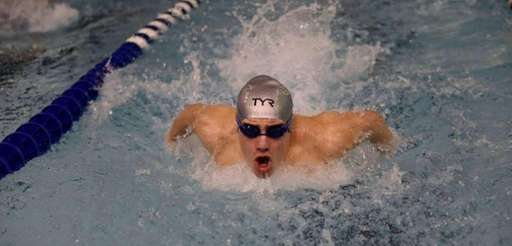Senior Syosset swimmer Tamir Zitelny competing in the