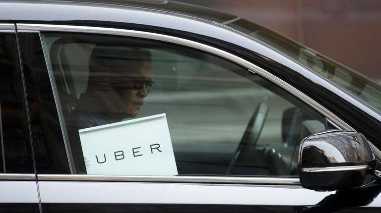 An undated file photo shows an Uber driver.