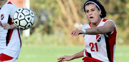 East Islip midfielder Cari Roccaro kicks the ball