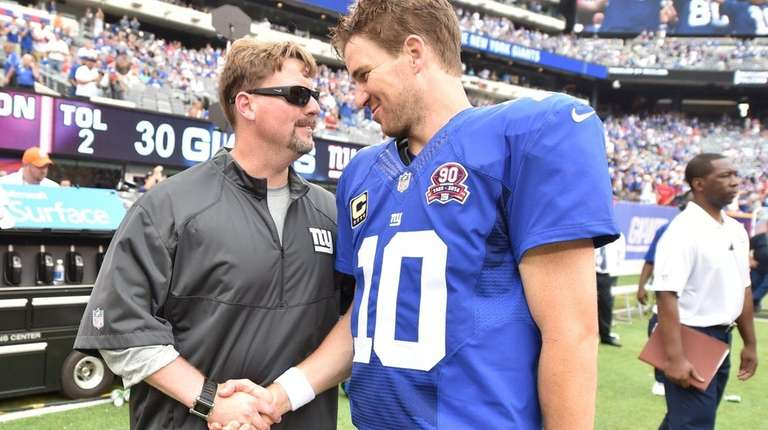 New York Giants quarterback Eli Manning shakes hands