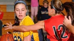 Gabriella Heimbauer #23 of Massapequa, left, shields the