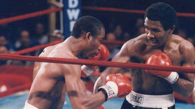 Ali Karim Muhammad, left, fights Howard Davis Jr.