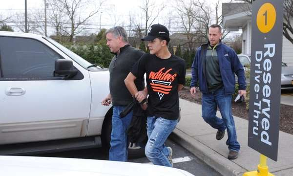 Police take Carlos Argueta, 16, into custody at
