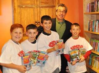 Author Chris Grabenstein with Kidsday reporters from left,