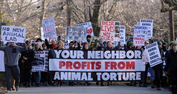 Animal rights activists march to the Halesite home