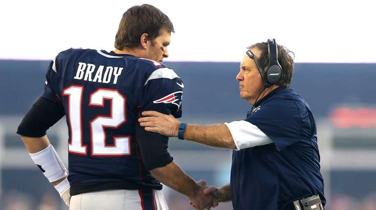 Tom Brady #12 and head coach Bill Belichick