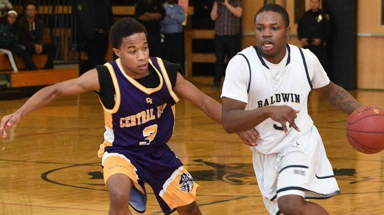 Baldwin's Jabeon Bivins drives the ball defended by