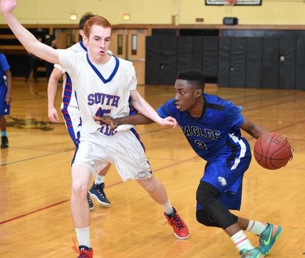 Copiague's Rigaud Destime drives the ball against South