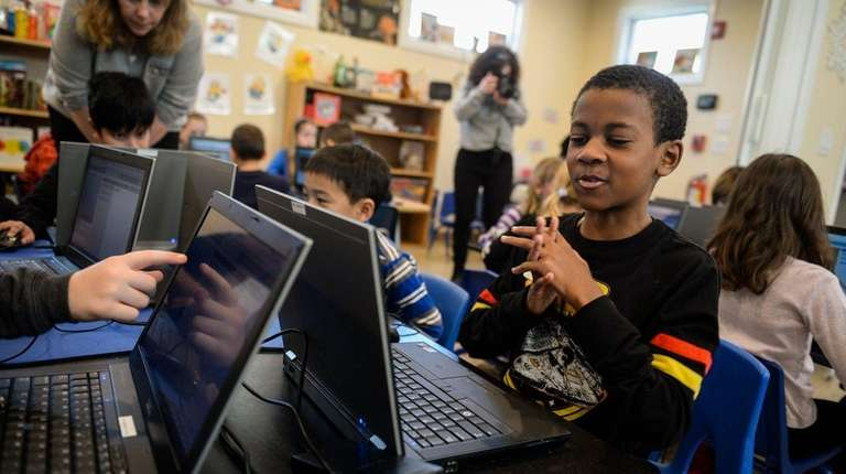 Xavier Wallace, 8, of Dix Hills, practices how