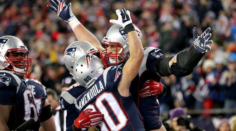 Rob Gronkowski, right, is embraced by Danny Amendola