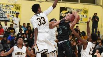 Brentwood's Michael Almonacy draws a foul against Uniondale
