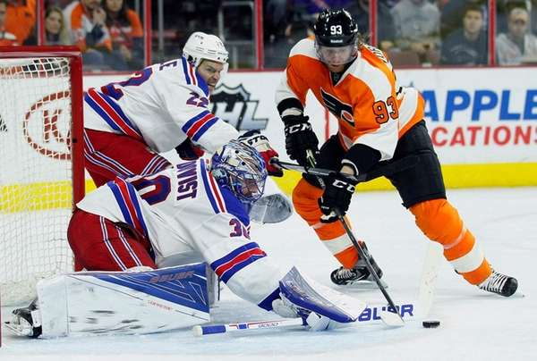 New York Rangers goalie Henrik Lundqvist deflects the