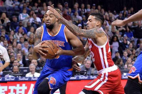 New York Knicks forward Derrick Williams, left, drives