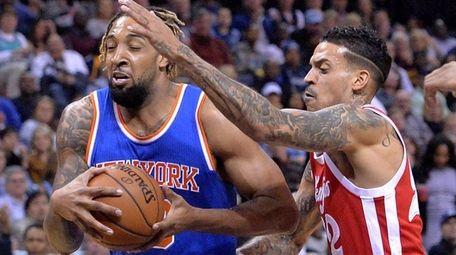 New York Knicks forward Derrick Williams, left, drives