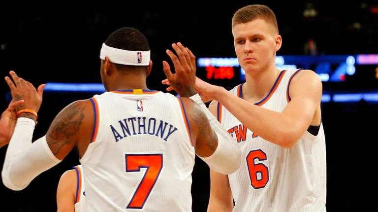 The Knicks' Kristaps Porzingis and Carmelo Anthony celebrate