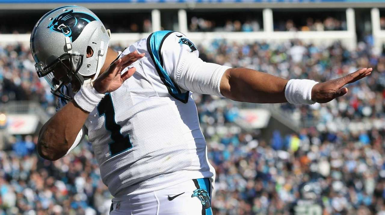 Cam Newton of the Carolina Panthers celebrates after