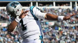 Cam Newton of the Carolina Panthers celebrates after