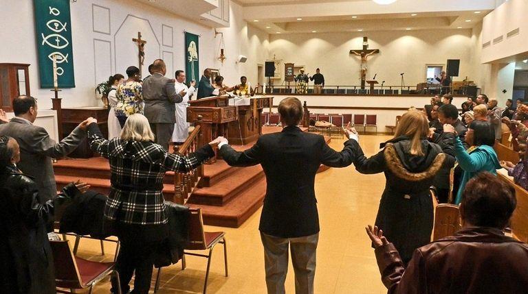 The Rev. John Ekwoanya celebrates a Mass in