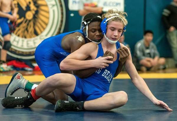 Long Beach's Jacori Teemer, rear, wrestles teammate