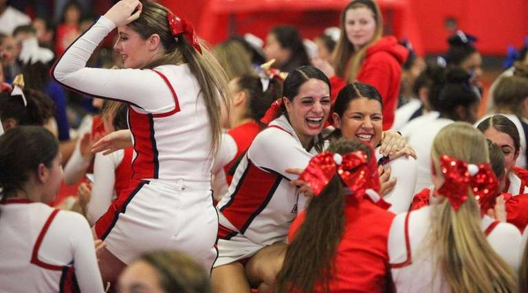 Smithtown East celebrates after placing 1st in the