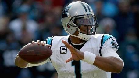 Cam Newton of the Carolina Panthers throws