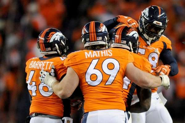 DeMarcus Ware of the Denver Broncos celebrates with