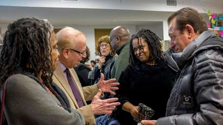 Congregants converse following a memorium for Dr. Martin