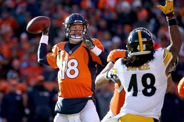 Peyton Manning of the Denver Broncos throws a